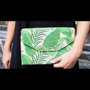 Awesome palm leaf clutch.